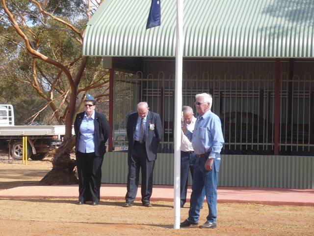 flag ceremony being performed at the 2011 ANZAC service