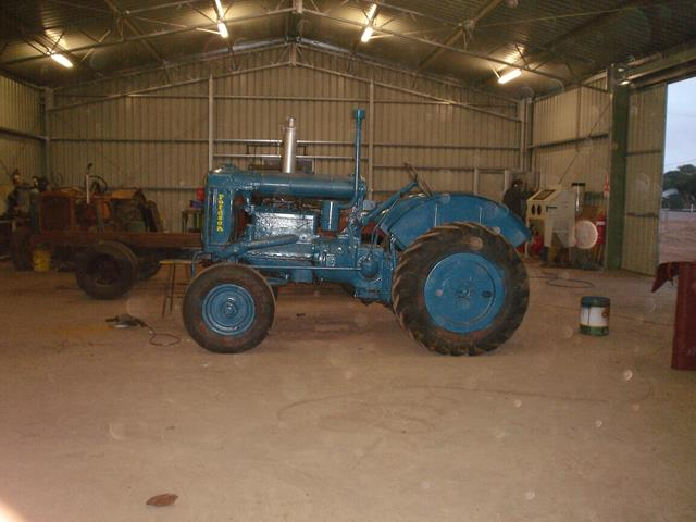 Restored Fordson Tractor standing inside Beacon Mens Shed