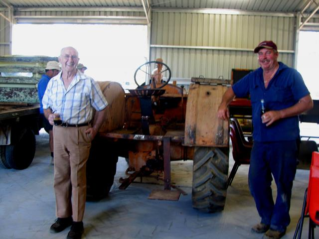 Beacon Mens Shed volunteers having a drink next to the Allis Chalmers tractor