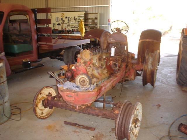 front view of stripped down vintage Allis Chalmers tractor