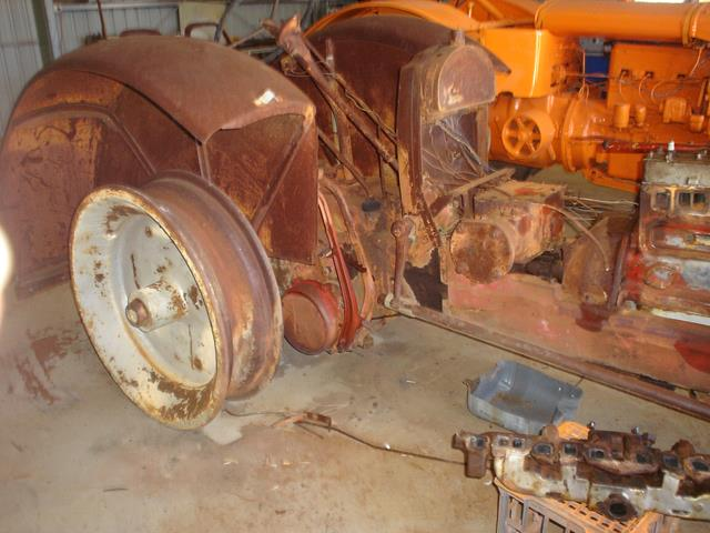 stripped down Allis Chalmers tractor during restoration