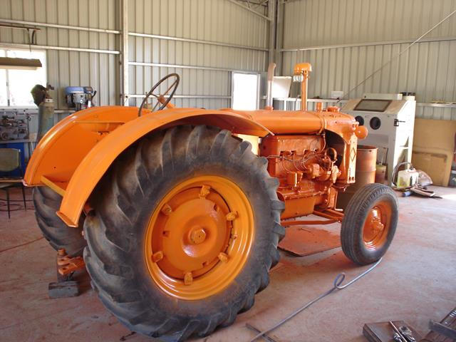 right side view of bright orange restored Allis Chalmers tractor