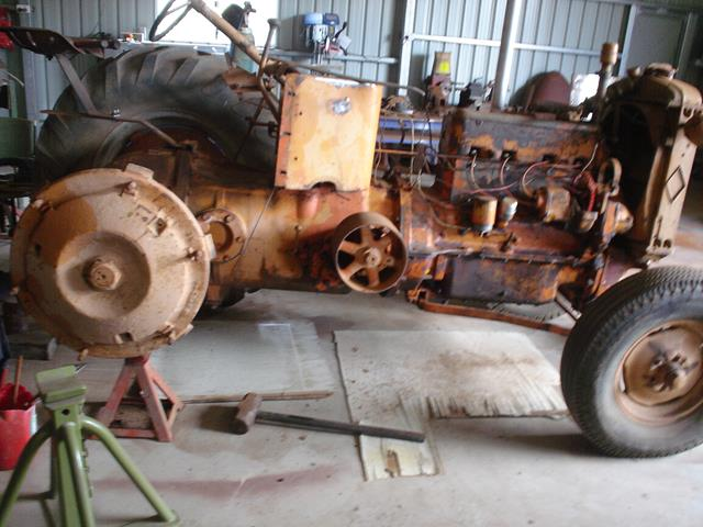 Allis Chalmers tractor on stands being taken apart for restoration