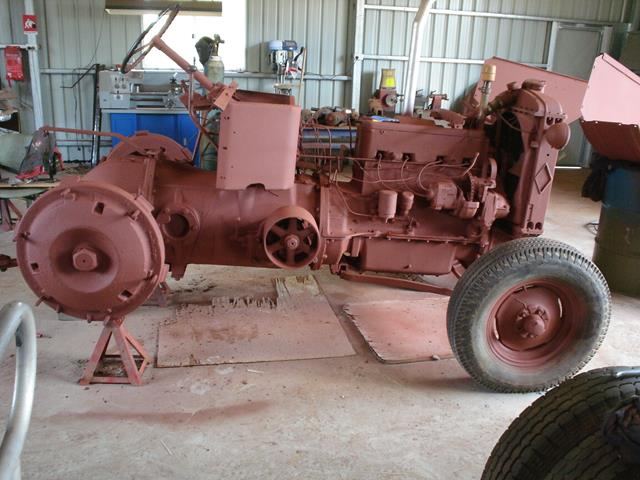 Allis Chalmers tractor with undercoat waiting for final part of restoration