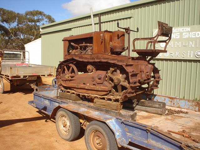 The original Holt Caterpillar arriving at Beacon Mens Shed for restoration