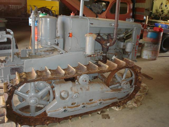 a side view of the Holt Caterpillar during restoration process