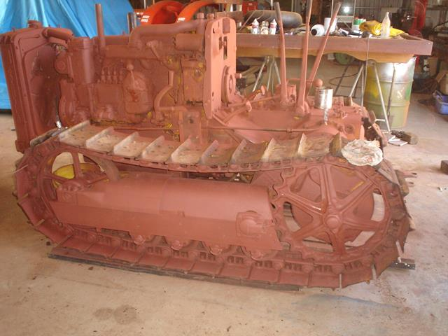 The part-restored Holt Caterpillar with red undercoat applied