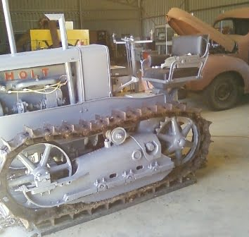 Restored caterpillar crawler inside Beacon Mens Shed