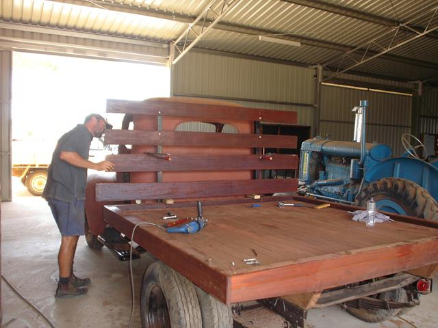 Custom made wood tray being fitted to International truck during restoration