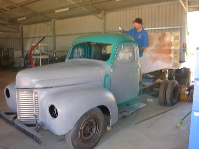 International truck with grey undercoat applied being finished with turquoise colour.