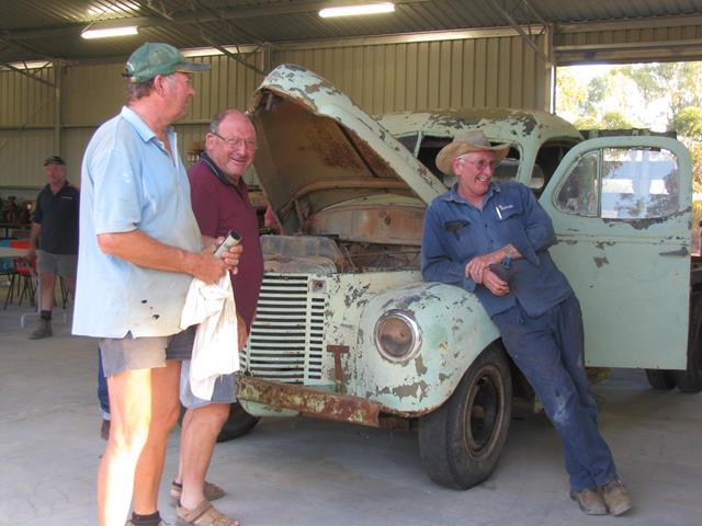 Volunteers sharing a break during International truck restoration