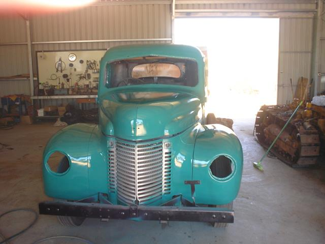 International truck with new paint before being refitted with headlights and windows
