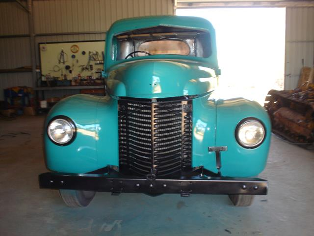 Front view of International truck with new turquoise paint job during restoration