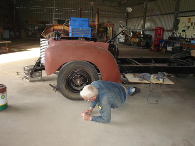 volunteer taking well earned break during International Truck restoration