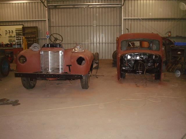 The unrestored International truck lying in pieces to be restored