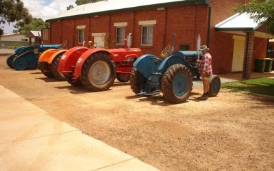 A line up of restored tractors outside the Beacon Town Hall