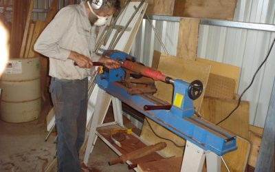 Beacon Mens Shed member working on the lathe